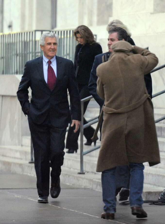 Former State Senator Joseph Bruno accompanied by his son Kenneth Bruno(r) is all smiles as he leaves the Federal Courthouse in downtown Albany, New York to wait for a verdict in his trial on ethics charges November 30, 2009.  (Skip Dickstein / Times Union) Photo: SKIP DICKSTEIN / 00006557A