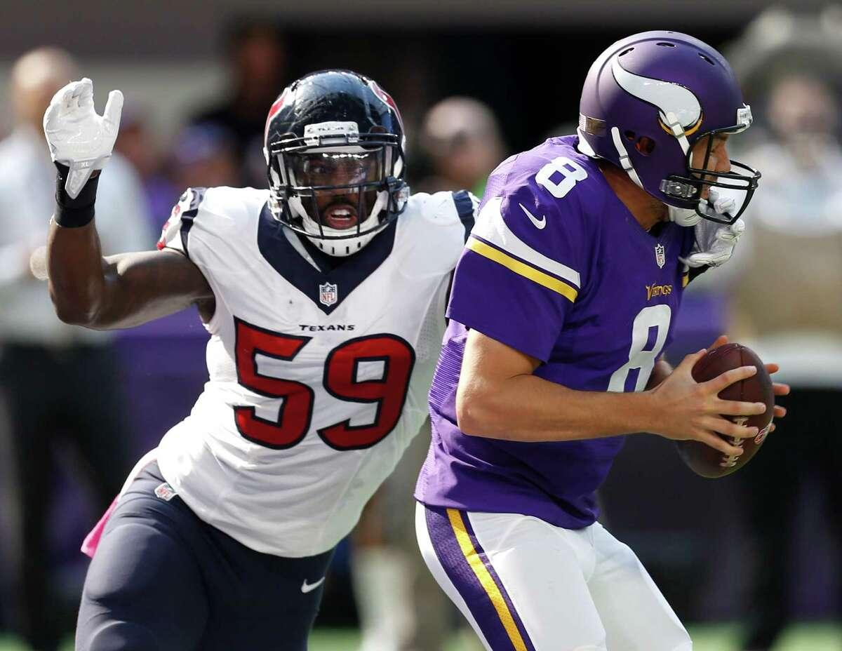 Texans linebacker Whitney Mercilus closes in on Vikings quarterback Sam Bradford on Sunday.
