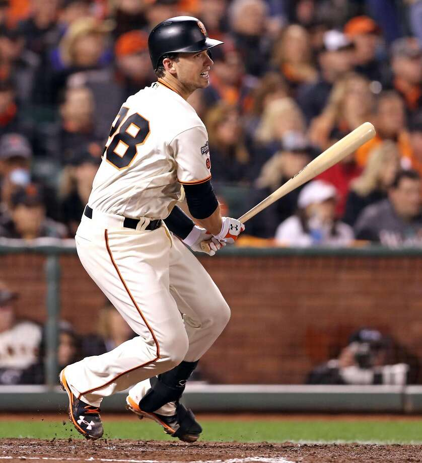Buster Posey will leave the Giants in the middle of spring training to play in the World Baseball Classic. Photo: Scott Strazzante, The Chronicle
