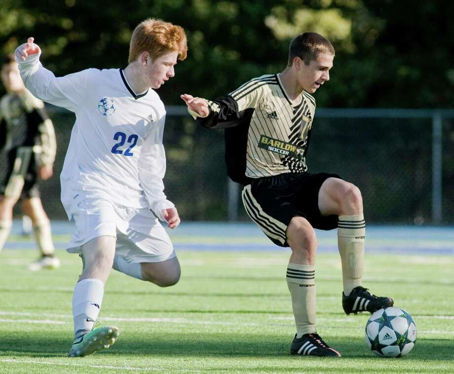 Newtown's Owen Sullivan, left, moves in on Barlow's Anthony Paolini during Monday's boys soccer game at Newtown High School. Photo: Scott Mullin / For Hearst Connecticut Media / The News-Times Freelance