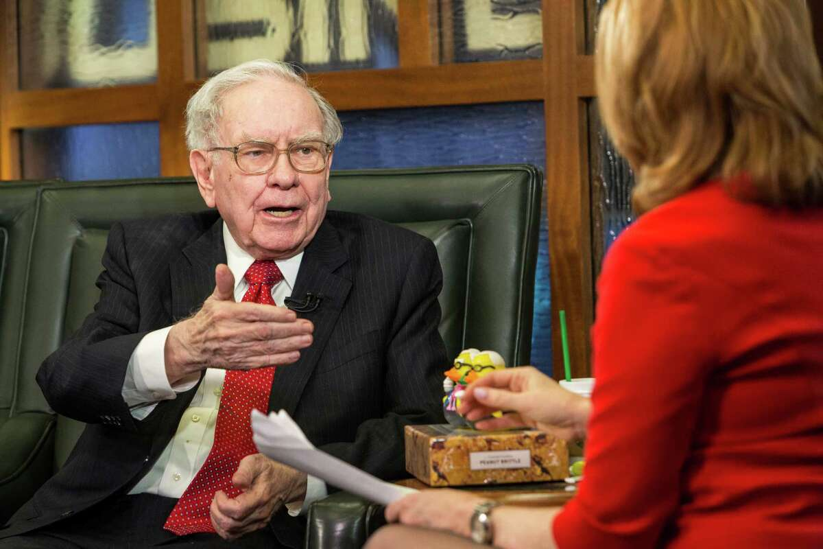 FILE - In this Monday, May 2, 2016, file photo, Berkshire Hathaway Chairman and CEO Warren Buffett speaks during an interview with Liz Claman on the Fox Business Network in Omaha, Neb. In a statement released Monday, Oct. 10, 2016, Buffett said heÂ?'s never used the kind of tax deduction Republican presidential candidate Donald Trump employed and he reiterated his call for the GOP nominee to release his tax returns. (AP Photo/John Peterson, File)
