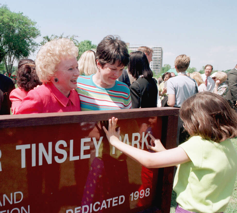 Angela Daniel traces the name of the park dedicated to her grandmother, Eleanor Tinsley, who looks on with her daughter, Marilyn Daniel, in 1998. Photo: Melissa Mahan, STAFF / HOUSTON CHRONICLE