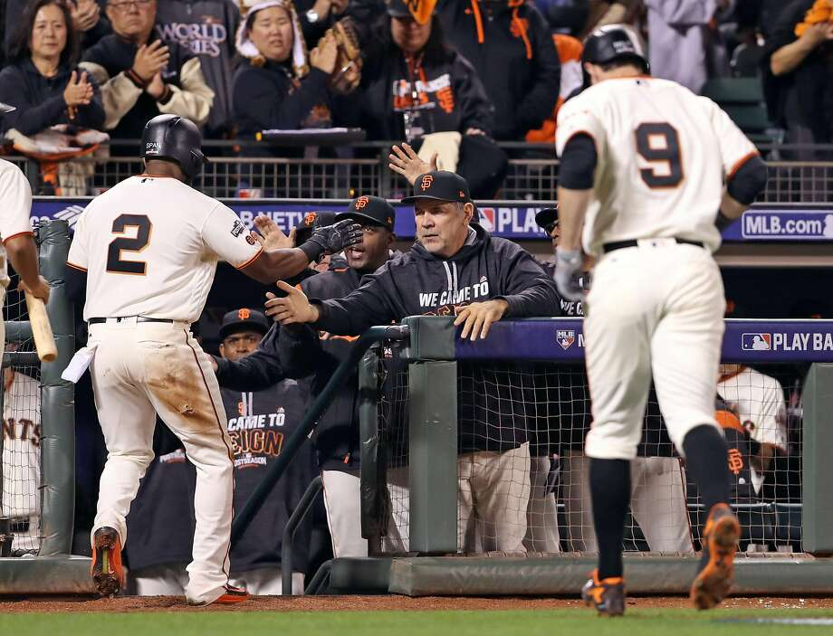 San Francisco Giants' Denard Span is welcomed back to dugout by manager Bruce Bochy after scoring on Brandon Belt's sacrifice fly in 5th inning against Chicago Cubs' Jake Arrieta during Game 3 of the National League Division Series at AT&T Park in San Francisco, Calif., on Monday, October 10, 2016. Photo: Scott Strazzante, The Chronicle