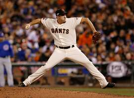 Giants' pitcher Derek Law throws in  the sixth inning, as the San Francisco Giants take on the Chicago Cubs in game 3 of the National League Division Series at AT&T Park on Mon. Oct , 8  2016, in San Francisco, California.
