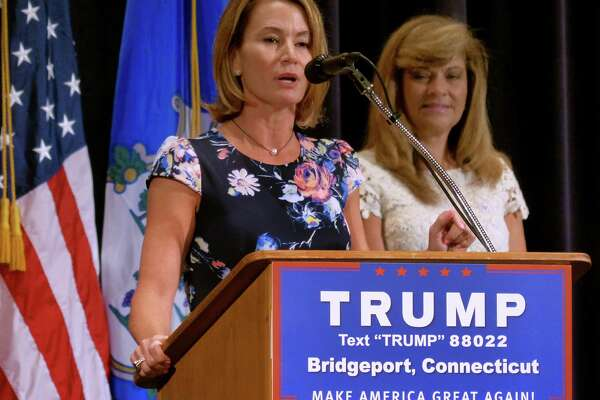 """House Minority Leader Themis Klarides, R-Derby, speaks at a rally for presidential candidate Donald Trump in Bridgeport in April. Klarides said she continues to """"re-evaluate"""" Trump on a daily basis and declined to endorse him on Monday."""
