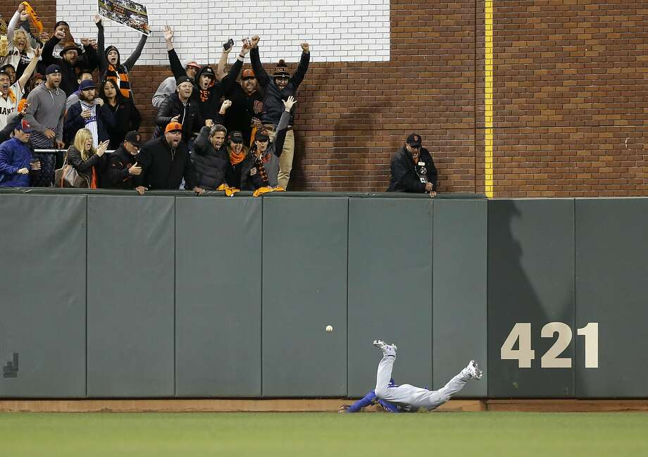 Cubs' Albert Almora dives for but can't catch Conor Gillespie's fly ball for a triple in the 8th inning, as the San Francisco Giants take on the Chicago Cubs in game 3 of the National League Division Series at AT&T Park on Mon. Oct , 8  2016, in San Francisco, California. Photo: Michael Macor, The Chronicle