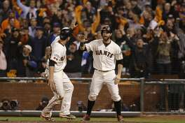 Giants' Conor Gillaspie's triple in the eighth inning scored BUster Posey, 28 and Brandon Belt, 9 as the San Francisco Giants take on the Chicago Cubs in game 3 of the National League Division Series at AT&T Park on Mon. Oct , 8  2016, in San Francisco, California.