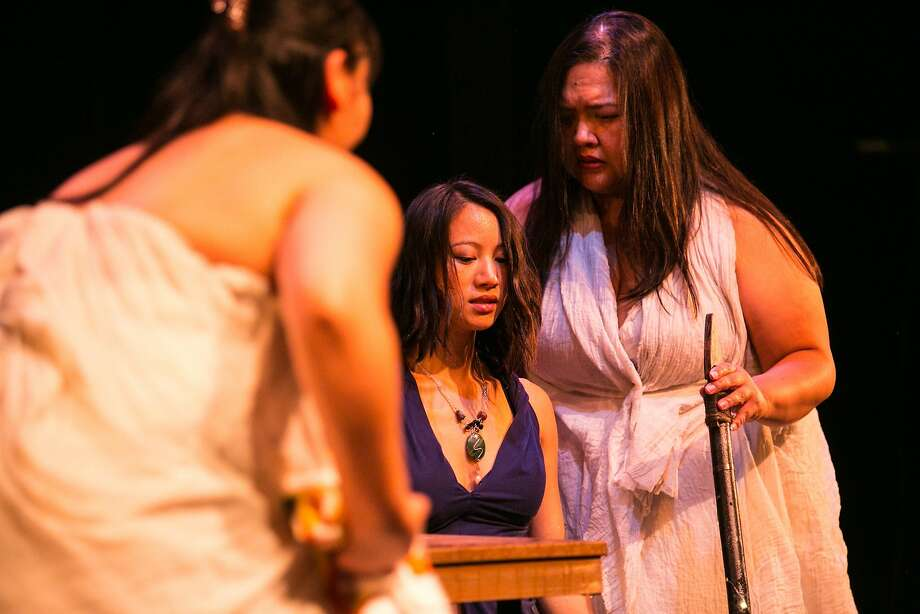 "Miranda (Grace Ng, center) learns the truth from her sisters (Marsha Dimelanta and Jennifer Jovez) in ""Bagyó."" Photo: Cheshire Isaacs, TheatreFirst"