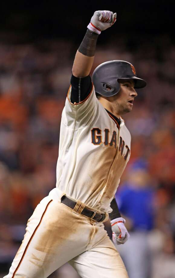 San Francisco Giants' Joe Panik celebrates his game-winning double in 13th inning of 6-5 win over Chicago Cubs during Game 3 of the National League Division Series at AT&T Park in San Francisco, Calif., on Monday, October 10, 2016. Photo: Scott Strazzante, The Chronicle