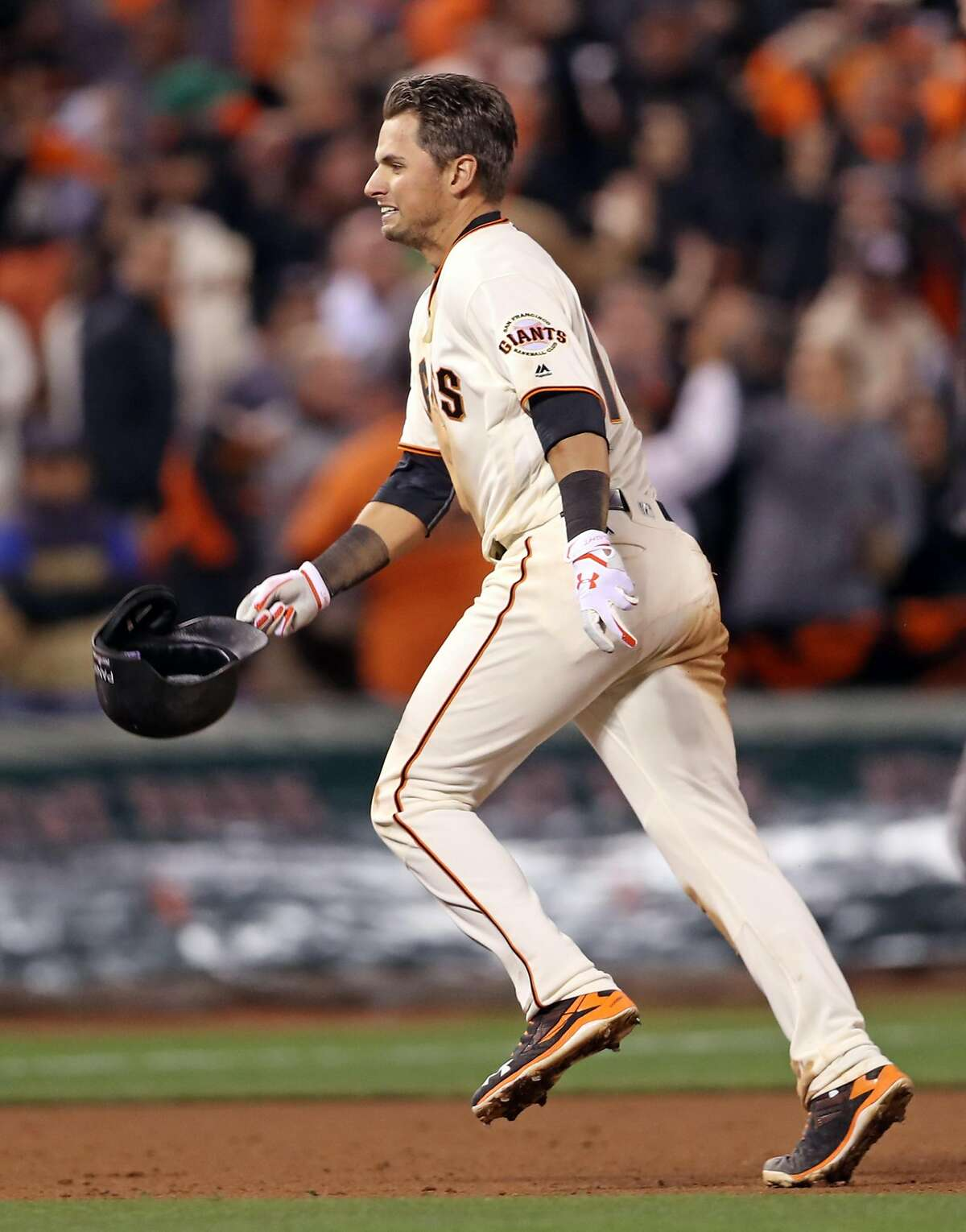 San Francisco Giants' Joe Panik celebrates his game-winning double in 13th inning of 6-5 win over Chicago Cubs during Game 3 of the National League Division Series at AT&T Park in San Francisco, Calif., on Monday, October 10, 2016.