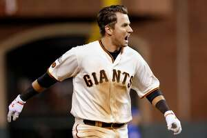 Giants' Joe Panik doubles in the winning run in the 13th inning as the San Francisco Giants beat the Chicago Cubs 6-5 in game 3 of the National League Division Series at AT& Park on Mon. Oct , 8 2016, in San Francisco, California.