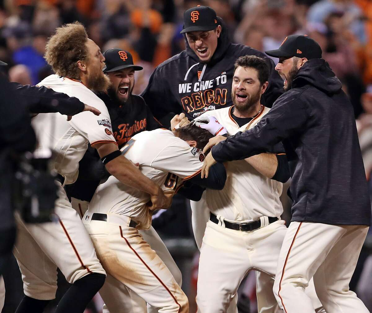 San Francisco Giants celebrate Joe Panik's game-winning double in 13th inning of 6-5 win over Chicago Cubs during Game 3 of the National League Division Series at AT&T Park in San Francisco, Calif., on Monday, October 10, 2016.