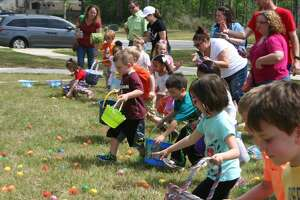 Kids are on the hunt for eggs with the help from parents during the Tavola Easter Egg Hunt Saturday, March 26, 2016.
