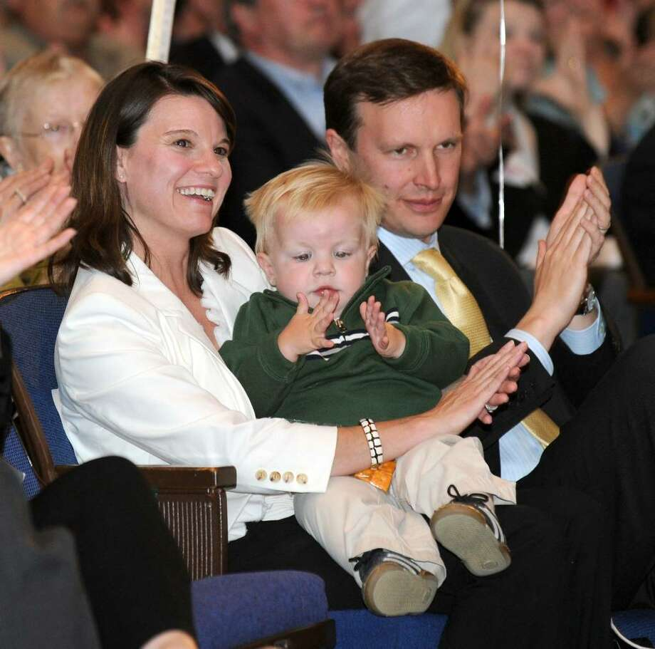 Congressman Chris Murphy, seated with his wife Cathy Holahan and son Owen, 1 1/2, listen to speakers at a nominating convention held at Crosby High School in Waterbury, Monday evening, May 10, 2010. Photo: Carol Kaliff / The News-Times
