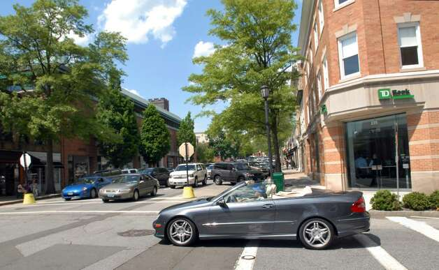Looking north up Greenwich Ave., a Mercedes-Benz convertible crosses Greenwich Avenue at East Elm Street, Tuesday afternoon, May 4, 2010. Photo: Bob Luckey / Greenwich Time