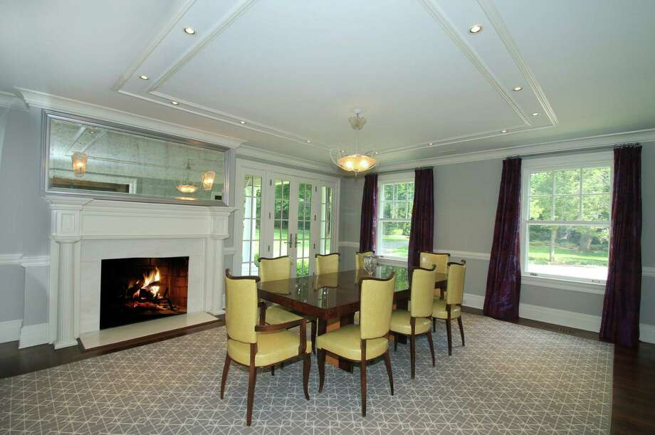 Dining room: The dining room has a fireplace, French doors to a covered porch, and provides access to a large butler's pantry. Photo: Contributed Photo / Hearst Connecticut Media / New Canaan News