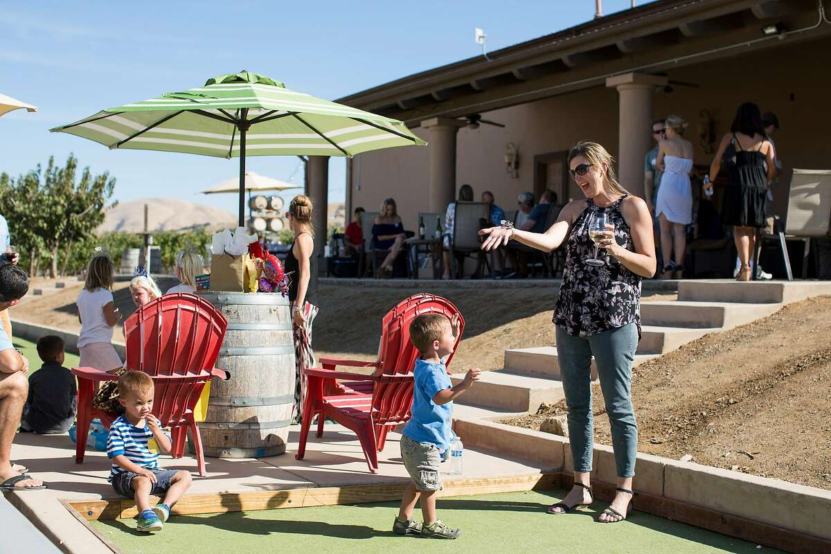 Heather Sakai plays bocce ball with her sons while attending a birthday party at McGrail Vineyards in Livermore, Calif., on Saturday, October 8, 2016.