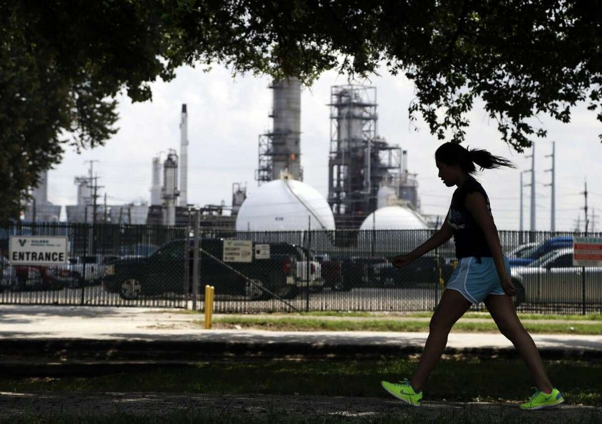 A teenage girl walks around the track of a park Aug. 4 near the Valero refinery in Houston.