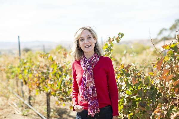 Chris Chandler, the executive director at Livermore Valley Winegrowers Association, poses for a portrait in the vineyards outside her office in Livermore, Calif., on Friday, October 7, 2016.