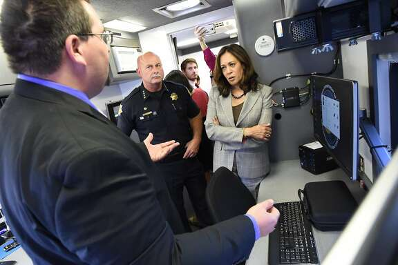 State Attorney General Kamala Harris and Fresno Chief Jerry Dyer get a tour from Department of Justice software specialist Tim Whitfield, left,  of the Cyber Response Vehicle (CRV), at Fresno State, Monday afternoon, Oct. 10, 2016, which will help local law enforcement throughout California perform efficient and advanced criminal investigations with a technology component like e-mail recovery, social media investigations, and advanced mobile forensics.