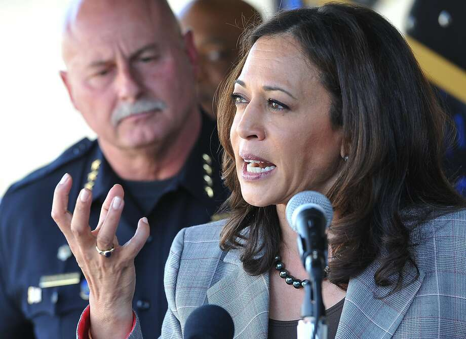 State Attorney General Kamala Harris  talks of the crack down on cyber crimes, with Fresno Chief Jerry Dyer, during her press conference to unveil the Cyber Response Vehicle (CRV), at Fresno State, Monday afternoon, Oct. 10, 2016. Photo: JOHN WALKER, Jwalker@fresnobee.com