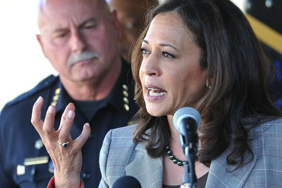 State Attorney General Kamala Harris  talks of the crack down on cyber crimes, with Fresno Chief Jerry Dyer, during her press conference to unveil the Cyber Response Vehicle (CRV), at Fresno State, Monday afternoon, Oct. 10, 2016. This will help local law enforcement throughout California perform efficient and advanced criminal investigations with a technology component like e-mail recovery, social media investigations, and advanced mobile forensics.