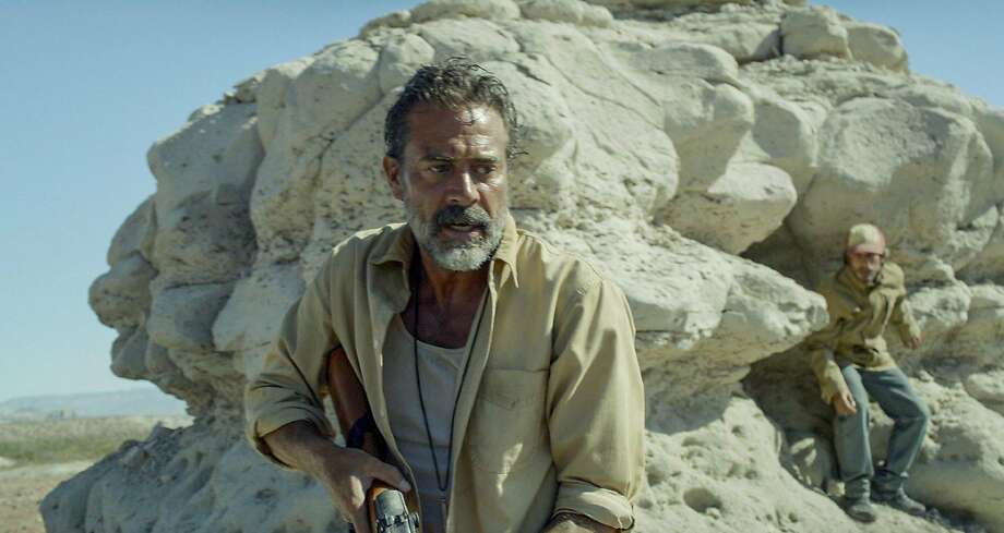 Jeffrey Dean Morgan plays Sam, the villain with a rifle and a killer dog who hunts Mexicans trekking through the desert to sneak into the United States and guns them down from afar. One such group slaughter is witnessed by Moises, played by Gael García Bernal (right), who is leading a second band through the desert. Photo: STX Productions, TNS