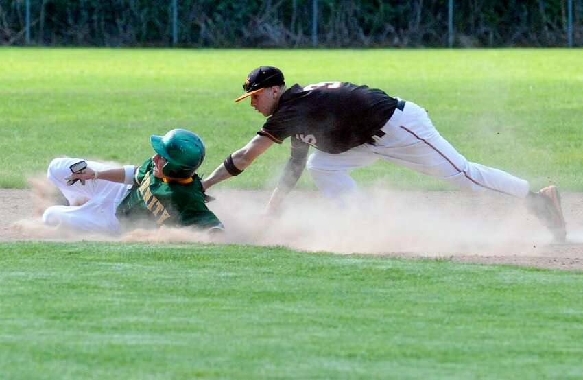 Trinity's Kyle Devico is tagged out by Stamford's Brandon Docimo as Trinity Catholic hosts Stamford High School in a boys baseball game Monday afternoon, May 10, 2010. Trinity won 5-4.