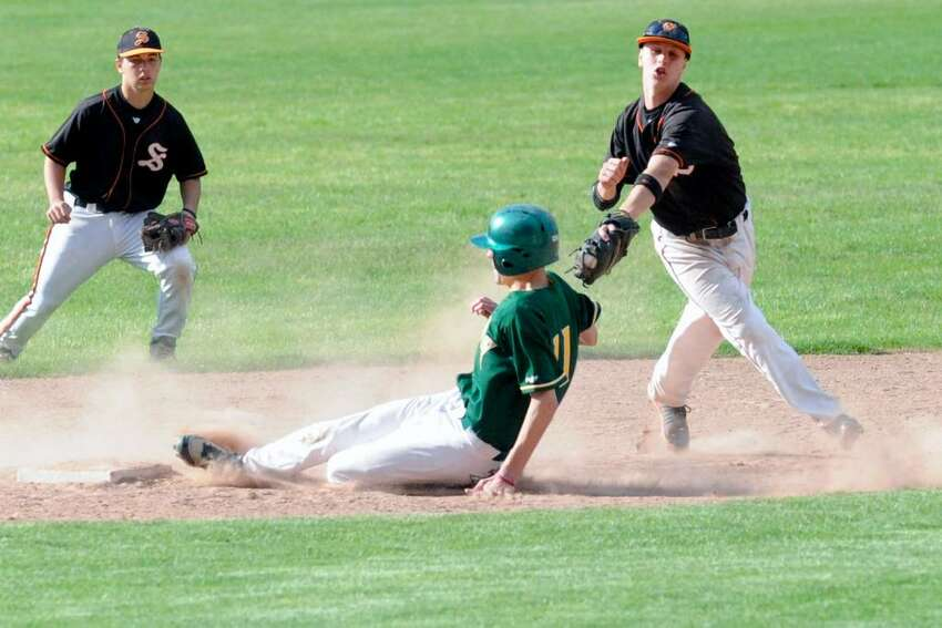 Trinity's Chris Cingari slides safely into second as Stamford's Brandon Docimo tries to make the play as Trinity Catholic hosts Stamford High School in a boys baseball game Monday afternoon, May 10, 2010. Trinity won 5-4.