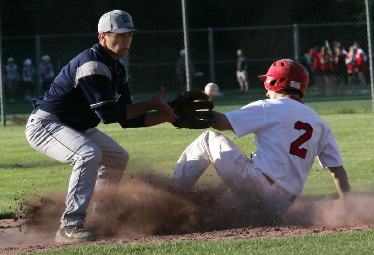 Greenwich High School's Ryan Brennan beat the tag from Wilton's Austin Gambee during Monday afternoons game in which the Warrior's went on to win 4-3