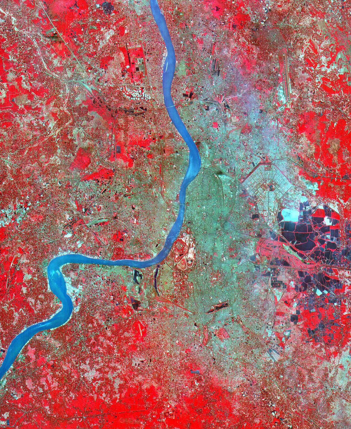 20. Kolkata/Calcutta, India, is bustling with 14,810,000 humans in an urban zone of some 465 square miles. NASA caption: In 1690 the British East India Company founded Calcutta as a trading post on the marshy east bank of the Hugli River. Chosen for its easily defensible location and its access to the Bay of Bengal, the site developed into an important trading port. In 1773 Calcutta was made the capital of British India. As merchants and workers from all over the Indian subcontinent flocked to the city, British interests prospered, and British colonizers built mansions and palaces on land reclaimed from the marshes and swampland. In 1912, however, Calcutta lost its position as the colonial capital to Delhi. The end of British rule in India in 1947 cut off many of Calcutta's sources of trade and brought a deluge of immigrants to the city. The Bangladesh war in 1971 exacerbated the influx of refugees. Today this vibrant city has a population of over 5 million, and continues to sprawl to the north and south from the central grid of its old European section.