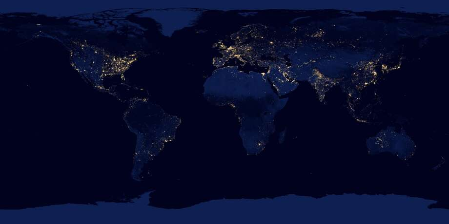 """Following are the 20 most populous cities and the square miles each one takes up. The data comes from the Demographia's """"World Urban Areas 2016."""" Photo: NASA"""