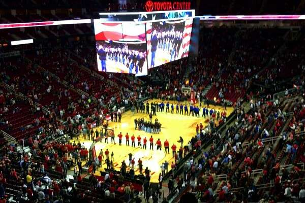 The Liberty High School choir took center court to perform the National Anthem before the Saturday, Nov. 21, Rockets game at the Toyota Center in Houston, Texas (Photo courtesy of LHS Principal Dr. Chad Barrett).