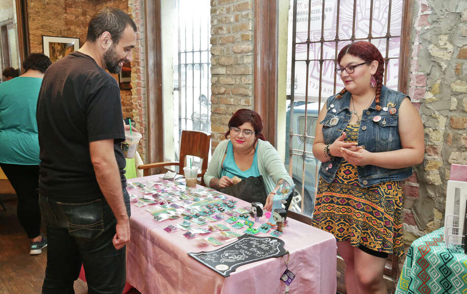 Jennifer Garza and Ashley Tristan sell some of their homemade items Friday afternoon during the Hecho a Mano Market at Gallery 201. Photo: Victor Strife, Cuate Santos | Laredo Morning Times