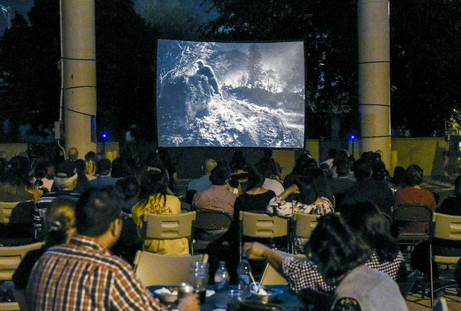 Laredoans watch a screening of Frankenstein Meets The Wolf Man on Friday night at the Villa Antigua Border Heritage Museum during it's movies on the patio night. The movie is the first of three screenings of classic horror films with the next movie set for October 14th, 2016. Photo: Danny Zaragoza/Laredo Morning Times