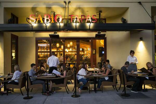 Customers eat dinner outside at global tapas restaurant Sabio on Main in downtown Pleasanton, Calif., on Saturday, October 8, 2016.
