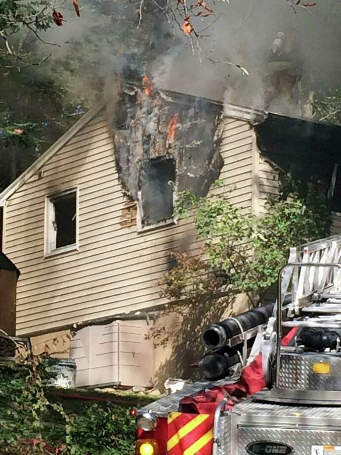 Newtown firefighters battled a house fire in Sandy Hook on Tuesday that officials say may have been caused by a portable heater. Photo: Contributed Photo / Hearst Connecticut Media / The News-Times Contributed