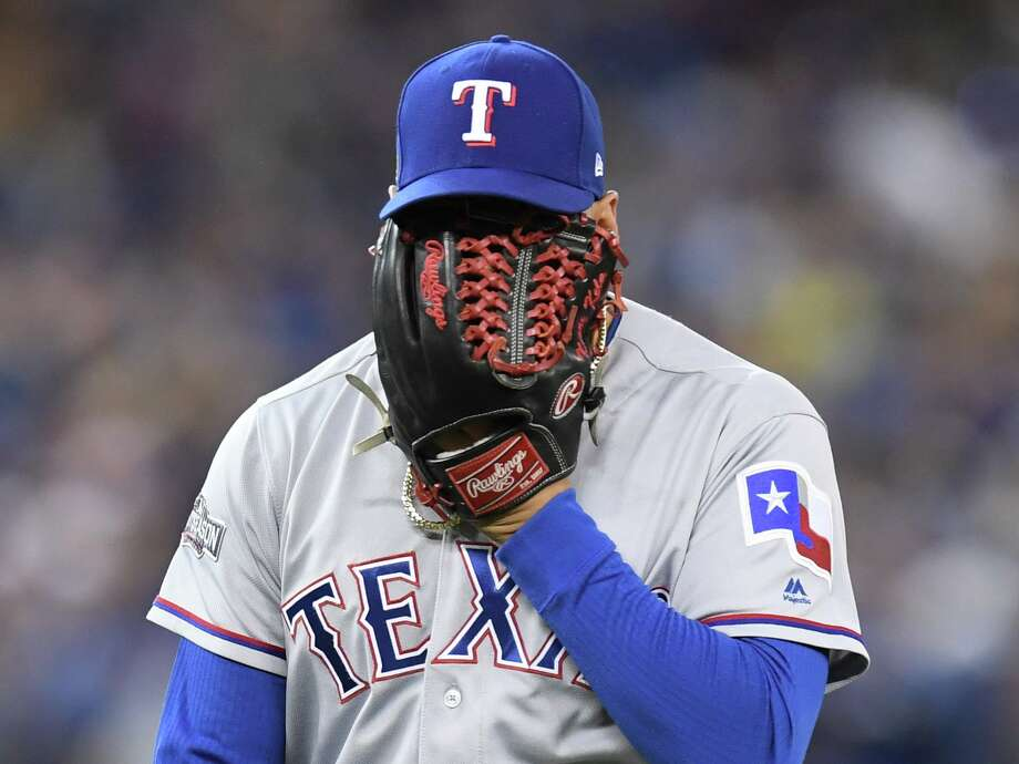 Texas Rangers' reliever Keone Kela yealls into his glove after giving up the game-tying run on a passed ball during sixth inning game three American League Division Series action, in Toronto on Sunday, Oct. 9, 2016. (Frank Gunn/The Canadian Press via AP) Photo: Frank Gunn/Associated Press