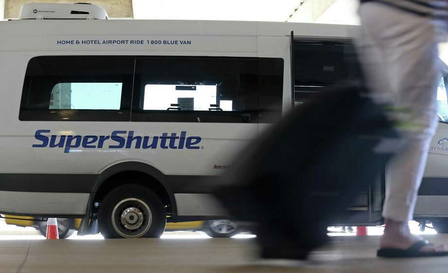 Eight former airport shuttle buses seized by the county earlier were sold at auction for a combined $48,000. Photo: Edward A. Ornelas /San Antonio Express-News / © 2016 San Antonio Express-News