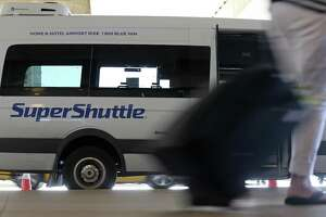 Eight former airport shuttle buses seized by the county earlier were sold at auction for a combined $48,000.