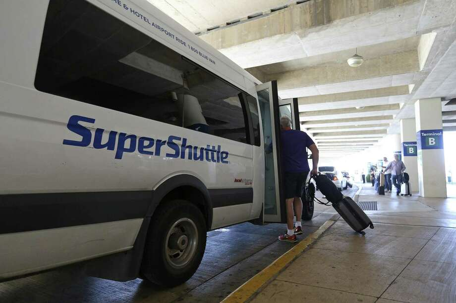 Former airport shuttle buses are being auctioned this month after they were seized by Bexar County. The opening bid for each of the vehicles is $1,000. Photo: Edward A. Ornelas /San Antonio Express-News / © 2016 San Antonio Express-News