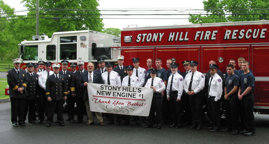The Stony Hill Volunteer Fire Department in Bethel stands in front of its latest appartus. (File photo May 2013) Photo: /