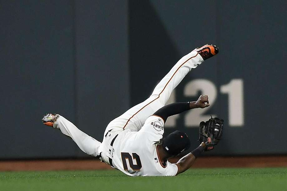 Denard Span of the San Francisco Giants makes a diving catch in the twelfth inning of the game against the Chicago Cubs during Game Three of their National League Division Series against the Chicago Cubs at AT&T Park on October 10, 2016 in San Francisco, California.  Photo: Thearon W. Henderson, Getty Images