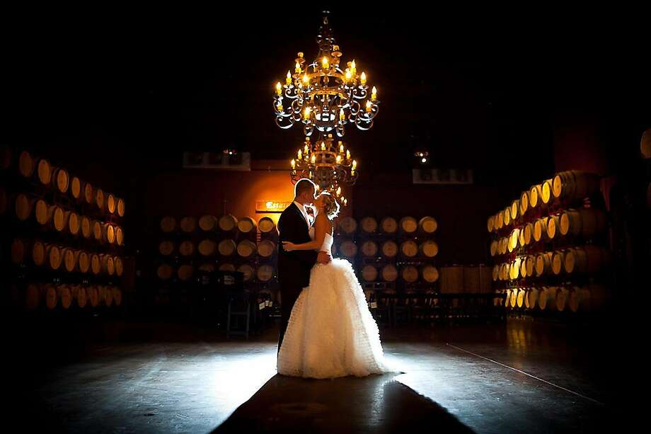 A couple enjoys a moment during their wedding day in the Estate Room at the Palm Event Center in the Vineyards.