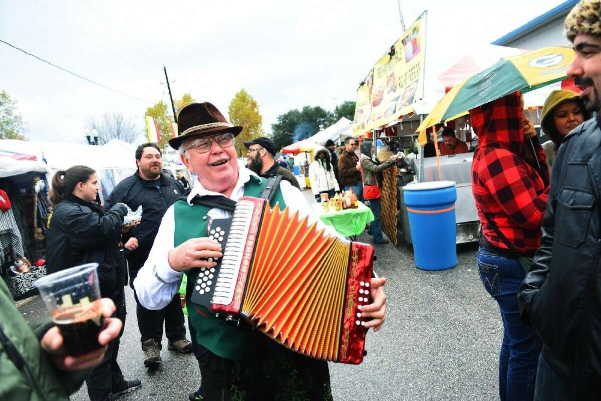 An accordianist plays a tune to passersby at the Tomball German Christmas Market on Sunday afternoon in downtown Tomball.