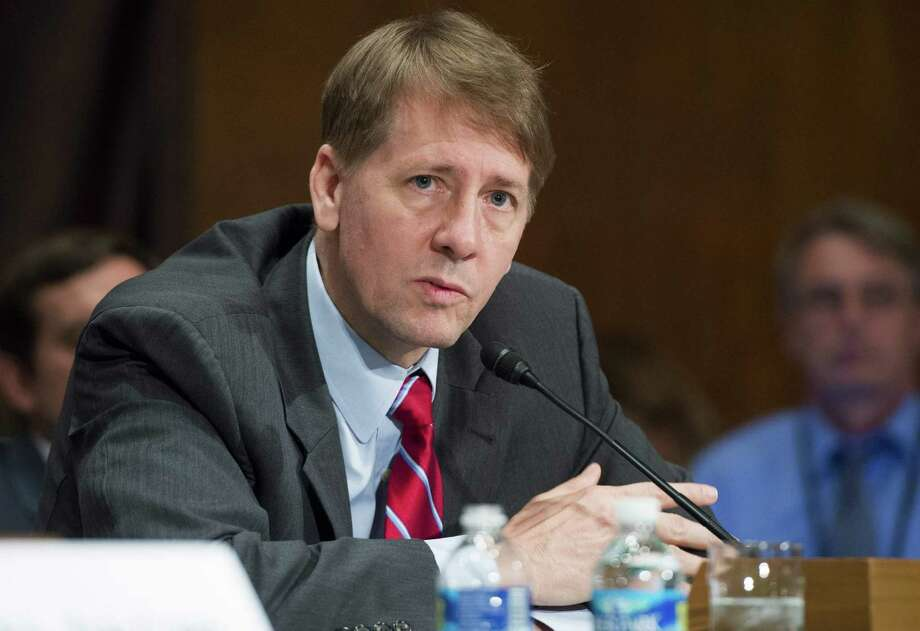 Director Richard Cordray of the Consumer Financial Protection Bureau testifies about the unauthorized opening of accounts by Wells Fargo during a Senate hearing. The agency's scrutiny of questionable financial aid programs in profit college industry is credited with the shuttering of many of those businesses in recent months. Photo: SAUL LOEB /AFP /Getty Images / AFP or licensors