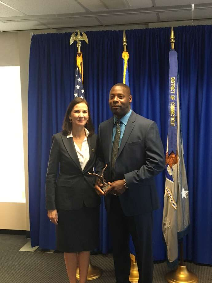 Jerry Junes receives a community policing award from Connecticut U.S. Attorney Deirdre Daly. Photo: Stamford Police Department
