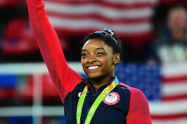 Gold medalist Simone Biles of the United States celebrates on the podium at the medal ceremony for the Women's Individual All Around on Day 6 of the 2016 Rio Olympics at Rio Olympic Arena on August 11, 2016 in Rio de Janeiro, Brazil.