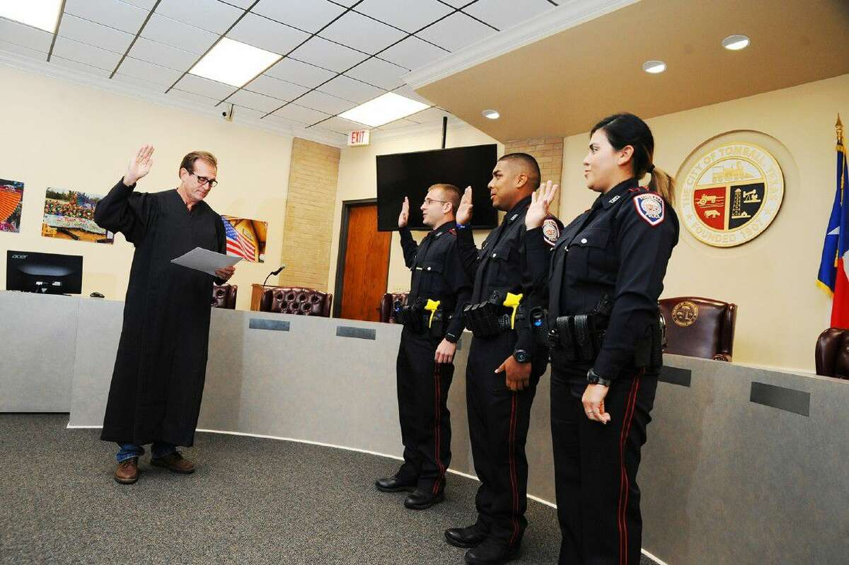 The Tomball Police Department swore in three new officers on Aug. 15. Pictured from left, Korey Orr, Camilo Flores and Juliete Pommer were sworn in by Judge Brett Peabody in the courtroom at Tomball City Hall.