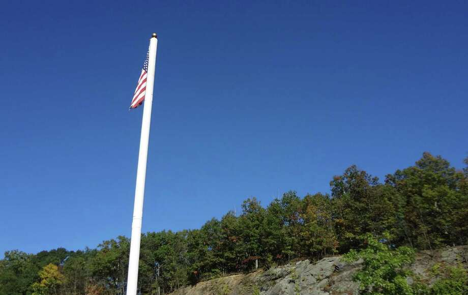 A monopole cell tower that does double duty as a flagstaff, in October 2016 just off Route 7 in Wilton, Conn. Municipal leaders have asked the Connecticut General Assembly to enact legislation to close a loophole in the state's regulations for the construction of wireless poles in public rights-of-way. Photo: Alexander Soule / Hearst Connecticut Media / Stamford Advocate